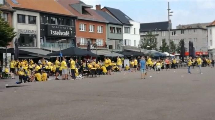 VIDEO. Deense fans genieten van terrasje in Genk