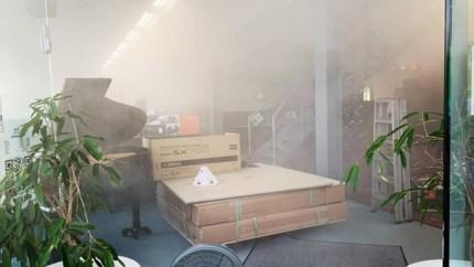 Mistalarm gaat per ongeluk af en vult muziekwinkel Jacky Claes met rook