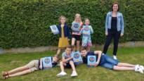 Gemeente Nieuwerkerken en Academie Haspengouw verdelen vakantieboek voor kinderen