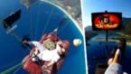 Paraglider kijkt rustig televisie vanuit luie zetel, meters hoog in de lucht maar zonder veiligheidsuitrusting