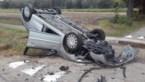 75-jarige vrouw botst met auto tegen tractor en gaat overkop
