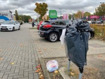 Vuilnisbakken dichtgeplakt wegens … te veel vuilnis